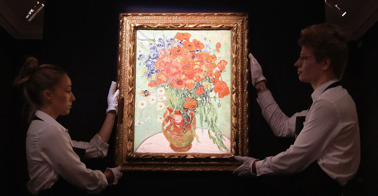 Gallery employees display art work