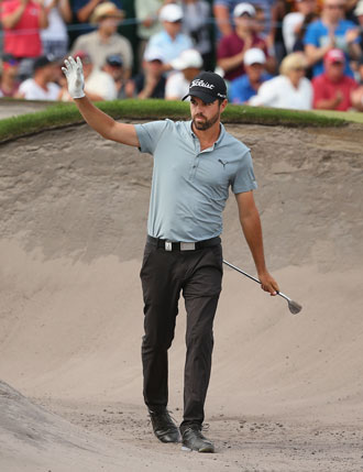 Cullen acknowledges the  applause after his bunker shot on the 18th. Photo: Getty