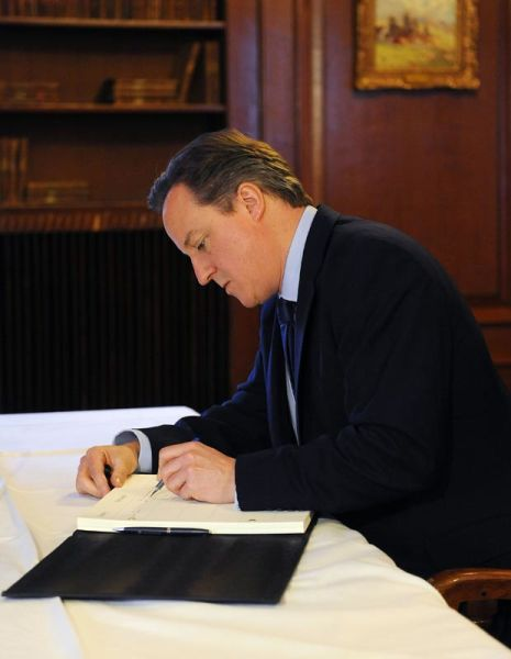 David Cameron shows his true colours when signing official documents.