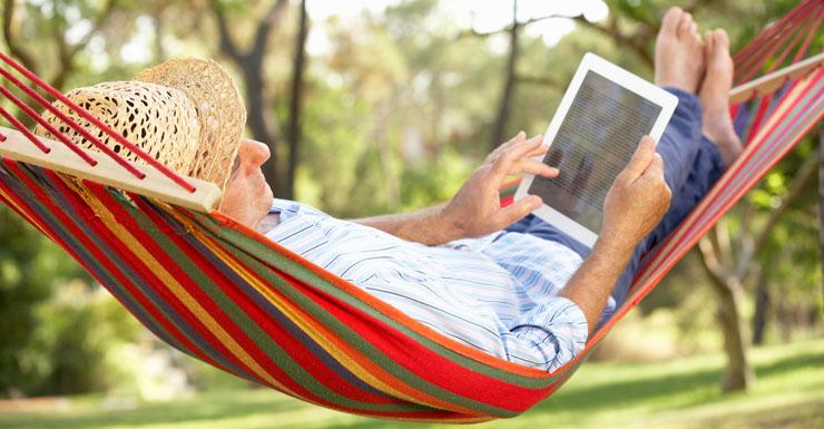 man reclines in hammock
