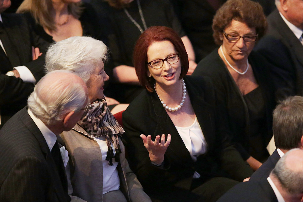 Julia Gillard speaking with former Prime Minister Malcolm Fraser inside the memorial.