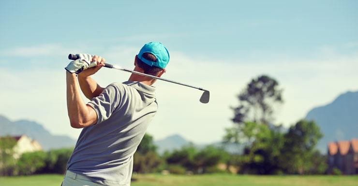 Man takes swing at golf club