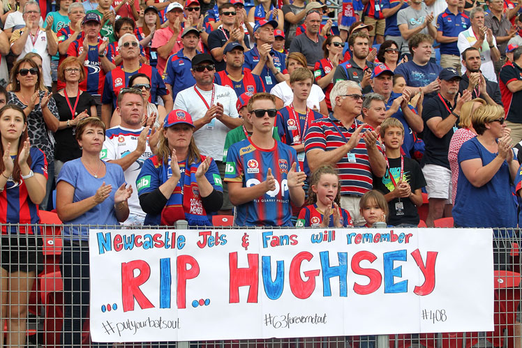 Newcastle applaud for Phillip Hughes at the 63 minute mark of the match against Central Coast Mariners. Photo: Getty