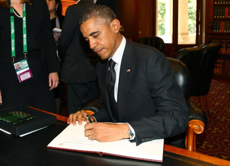 Barack Obama switches hands depending on the task.