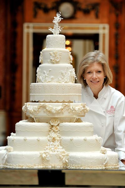 Cake designer Fiona Cairns poses with the royal wedding cake. Photo: Getty