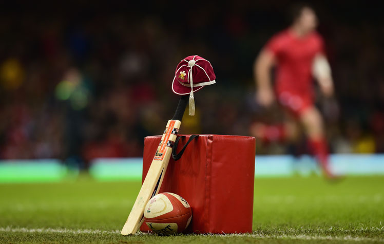 In Cardiff, Wales, a cricket bat and a Welsh cap are laid out in memory of Hughes before the match against South Africa. Photo: Getty