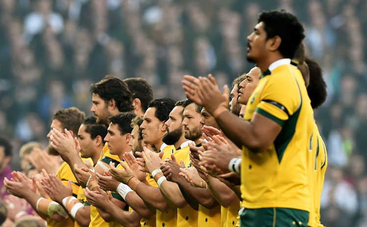 The Wallabies observe a minute's applause for Hughes at Twickenham. Photo: Getty