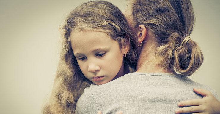Hug sad child Shutterstock