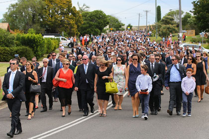 The funeral procession heads down Wallace Street, Macksville. Photo: Getty