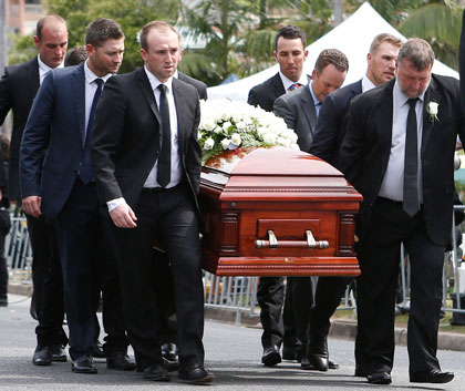 Brother Jason (front left), Michael Clarke (behind Greg) and father Greg act as pallbearers. Photo: Getty