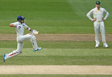 ... before posting his century, much to the joy of Australian captain Steven Smith. Photos: Getty