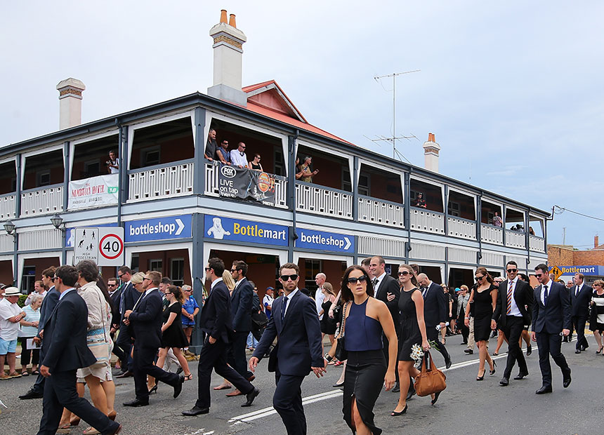 The funeral procession passes the pub in Macksville.