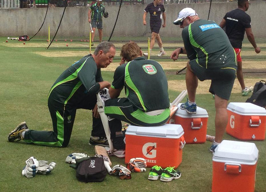 Shane Watson is tended to by team doctor Peter Brukner.