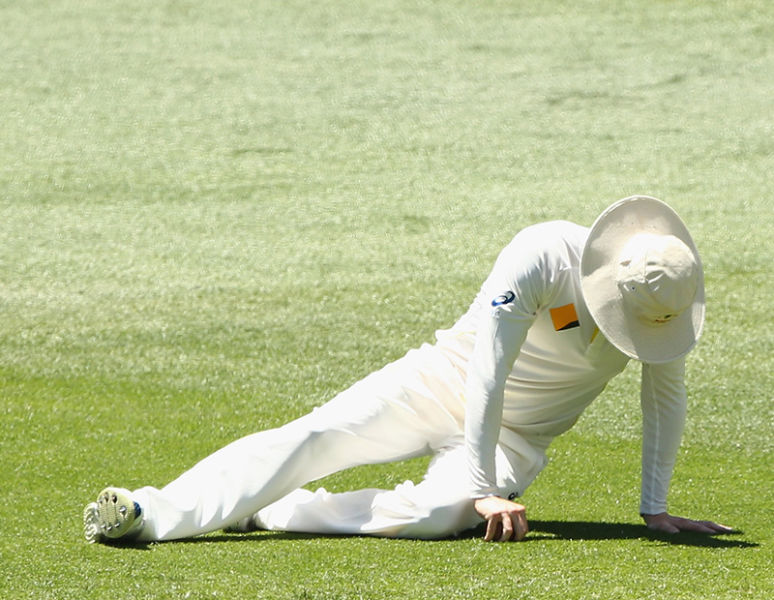 Michael Clarke goes down with his right hamstring injury yesterday. Photo: Getty