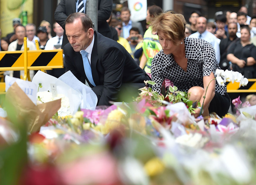 Tony Abbott and his wife Margaret lay wreaths at a makeshift memorial in Martin Place.