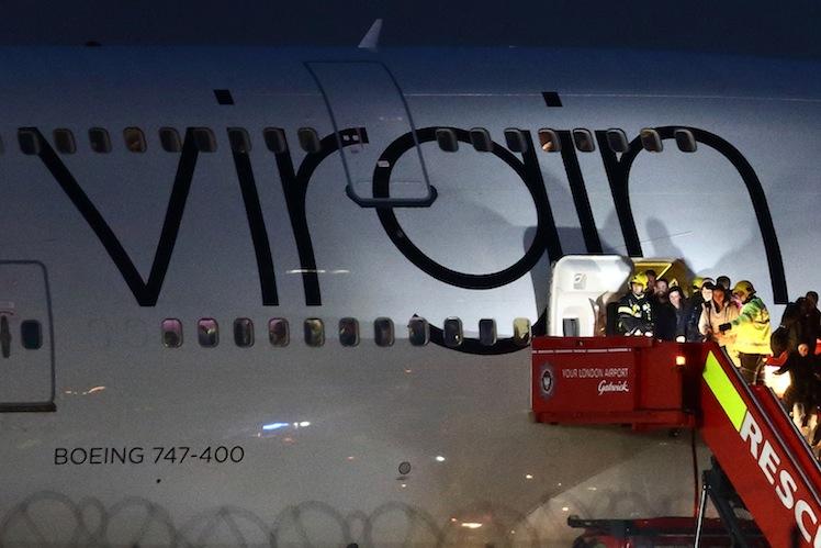 Passengers disembark the plane. Photo: Getty