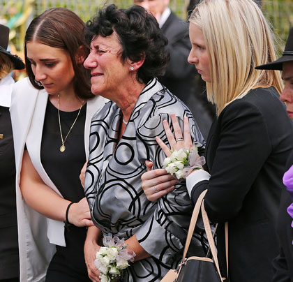 Phillip Hughes' sister Megan (L) and mother Virginia (C). Photo: Getty