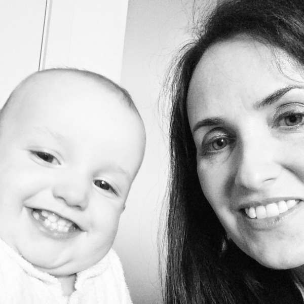 Jody with one of her six children that she cleverly budgets for. Photo: Six Little Hearts