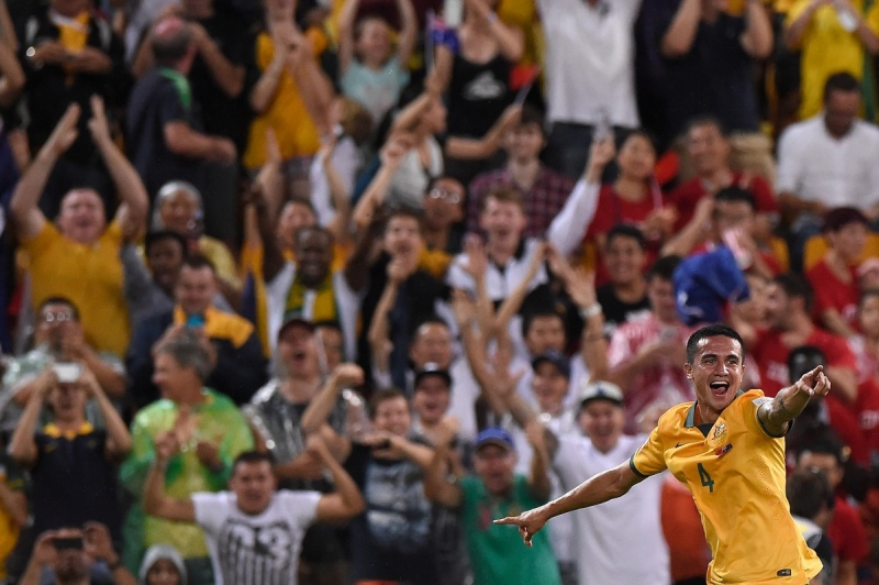 Cahill wheels away to celebrate his second strike as Brisbane's crowd goes crazy. Photo: Getty