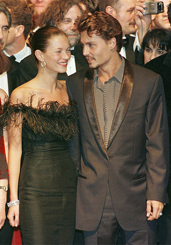 Super cool: With then partner Kate Moss at the premiere of Fear and Loathing in Las Vegas at Cannes in 1998. Photo: AAP