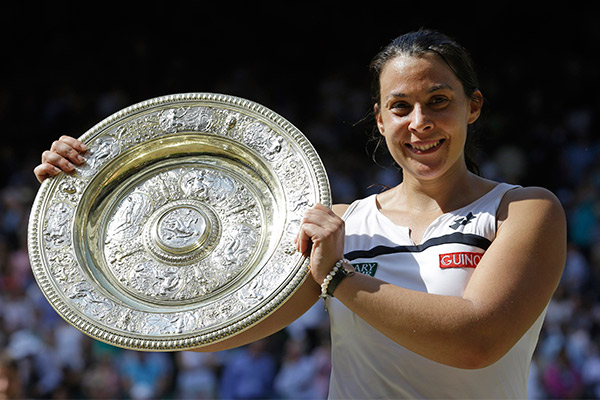 Wimbledon 2013 champion Marion Bartoli received ridiculously sexist commentary after her win. Photo: AAP