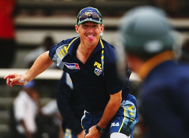 Brad Hogg of Australia bowls
