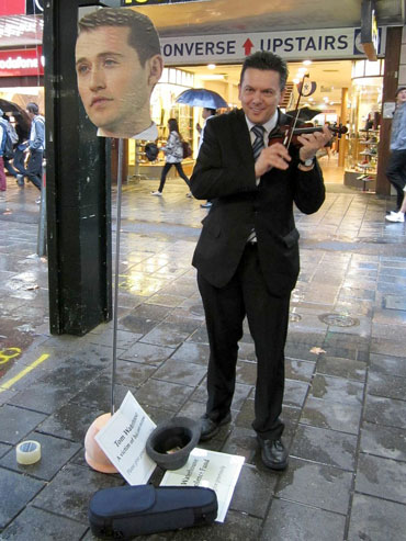 Busking 'for' Tom Waterhouse in 2013 after the entrepreneur complained about the difficulties of running a gambling business in Australia. Photo: AAP