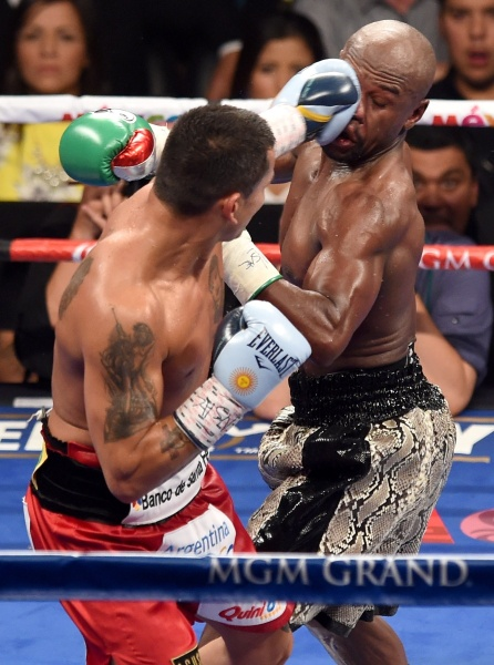 Floyd's handed out many hits during his career - but here, he takes one in his last bout. Photo: Getty