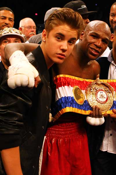 Floyd Mayweather celebrates another win with a young fan. Photo: Getty