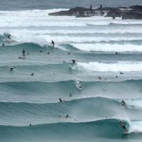 Surfer made the most of the whipped-up swell. Photo: AAP