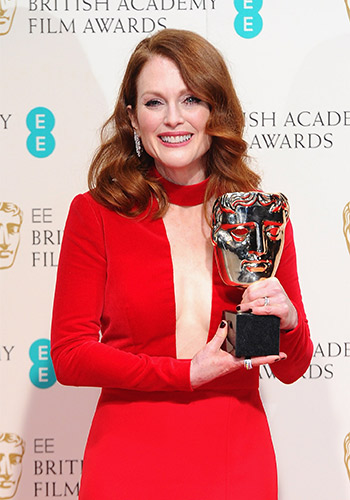Julianne Moore with her Best Actress BAFTA for Still Alice. Photo: Getty