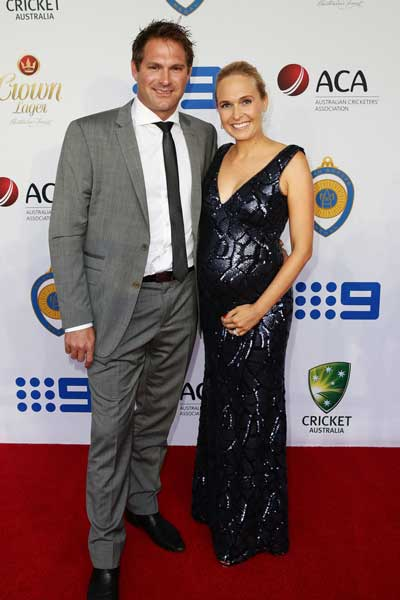 The 'tradie' suits up: Harris with wife Cherie. Photo: Getty