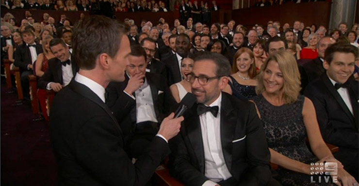 Harris chats with Steve Carrell during one of his off-stage skits. See Channing Tatum's face behind Carrell to see who it went down.
