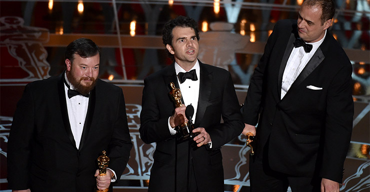 Thomas Curley, from left, Craig Mann and Ben Wilkins accept the award for best sound mixing for Whiplash.