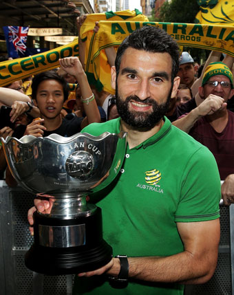 Mile Jedinak shows off the Asian Cup during celebrations in Sydney on Sunday. Photo: Getty