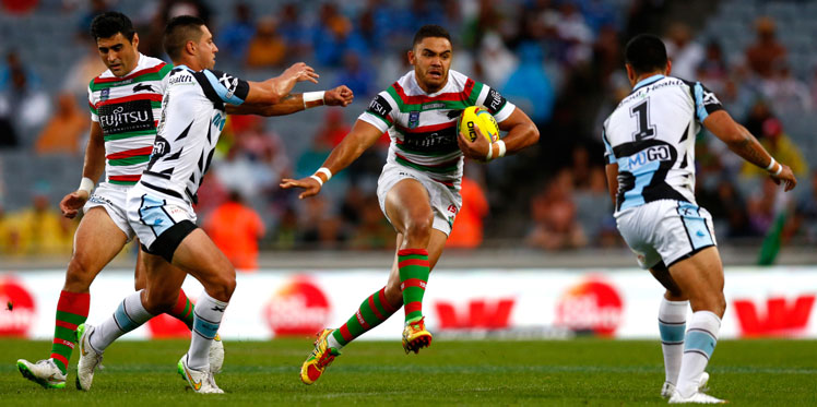 Dylan Walker of the Rabbitohs finds a gap during the Auckland Nines grand final against Cronula. Photo: Getty