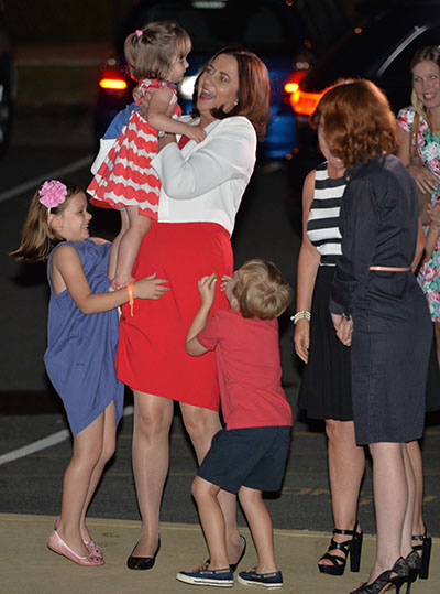 Annastacia Palaszczuk is greeted by children as she arrives for an election night function. Photo: AAP