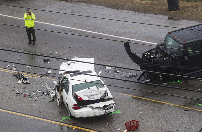 A sheriff at the scne of the fatal crash in Malibu. Photo: AAP