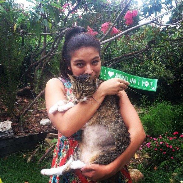 Clara with her cat, Strippy.