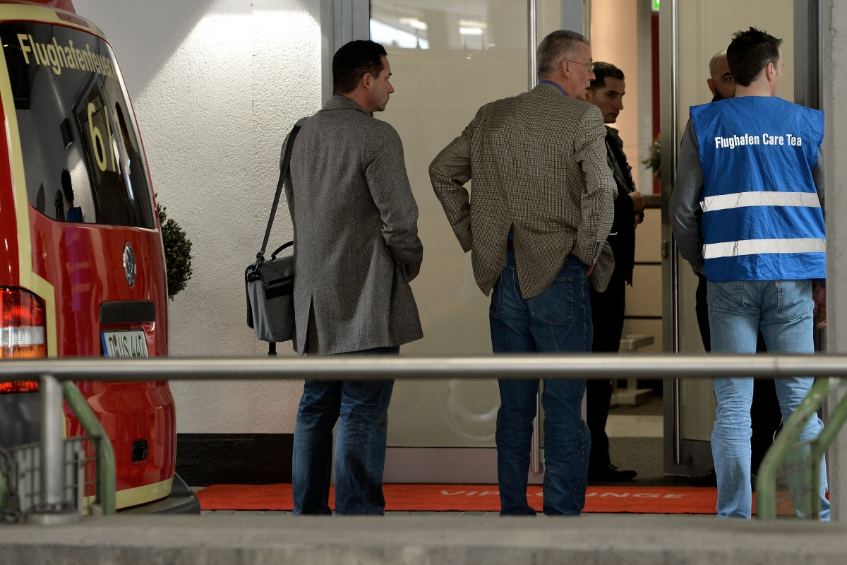 People arrive at a holding area for friends and relatives of passengers on Germanwings