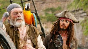 Johnny Depp (right) as Jack Sparrow in a scene from a Pirates of the Caribbean movie.