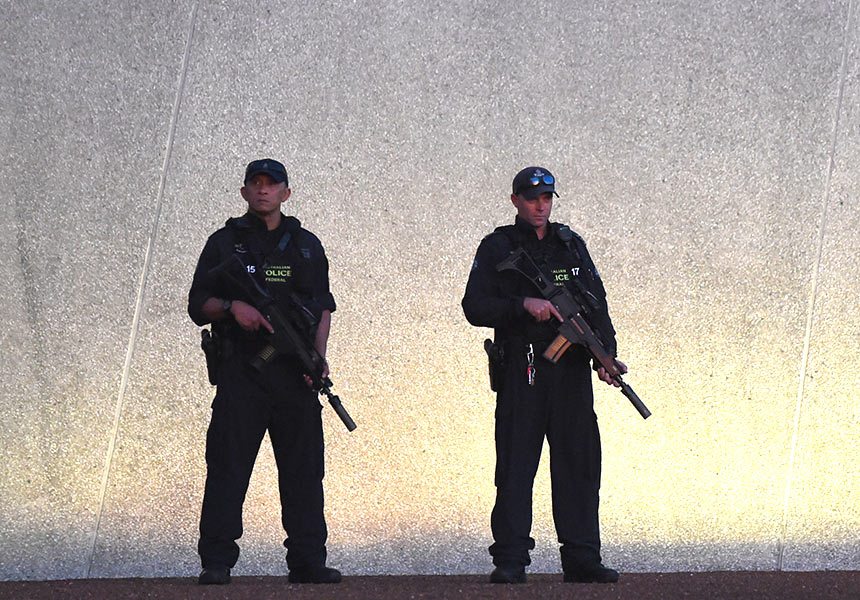 Australian Federal Police officers outside Parliament House in Canberra