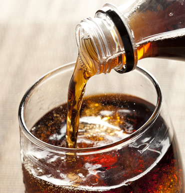 Soft drink pour shutterstock