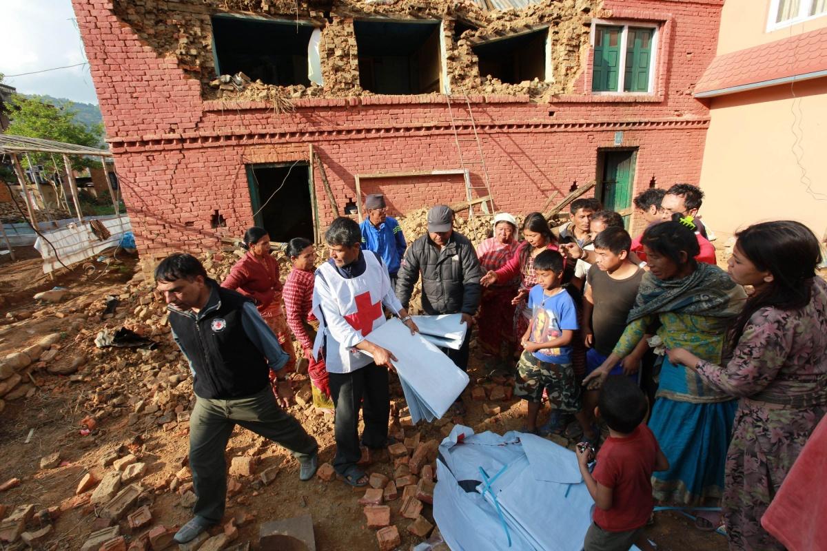 Red Cross distribute tarpaulins to displaced residents in Kathmandu.