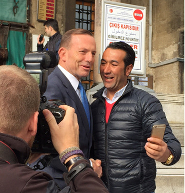 Tony Abbott poses with a visitor who wanted a selfie at the Blue Mosque in Istanbul, Turkey.