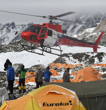 A rescue helicopter prepares to land and airlift the injured from Everest Base Camp, befall earthquake. Getty