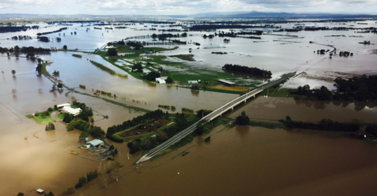 An aerial photograph of the Hunter Valley shows the storm damage.