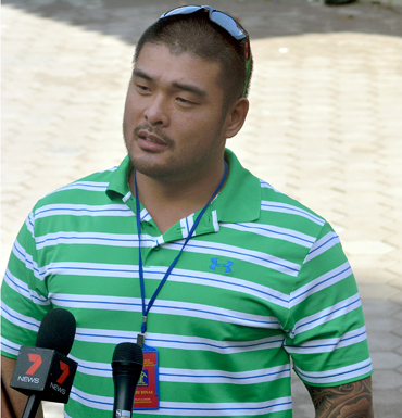Michael Chan, brother of Andrew, faces the media.