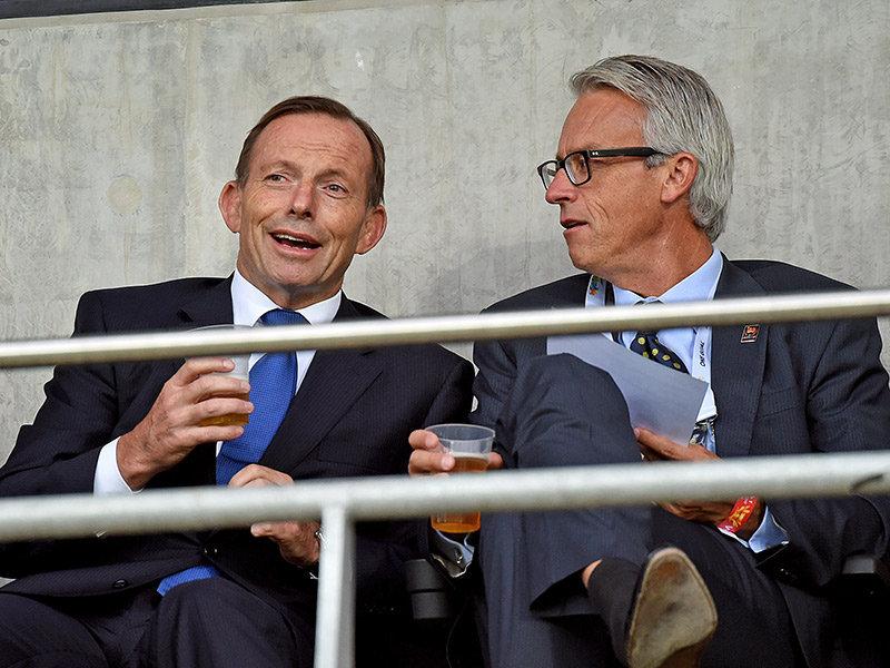 Tony Abbott drinks a beer