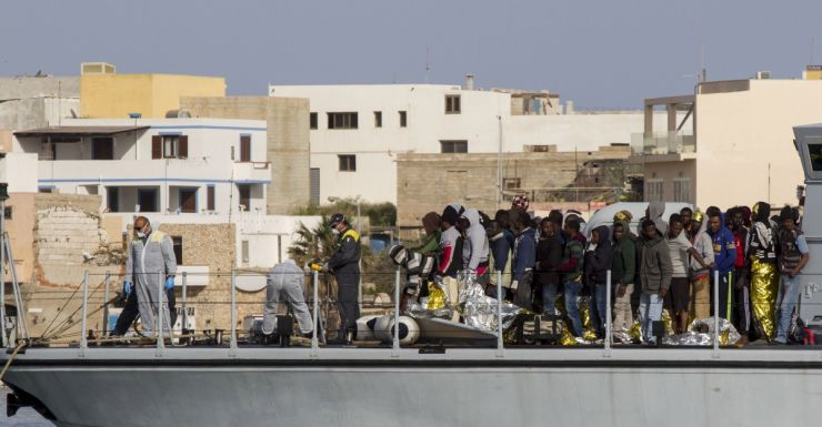 Rescued migrants arrive in the harbor of Lampedusa, Southern Italy.